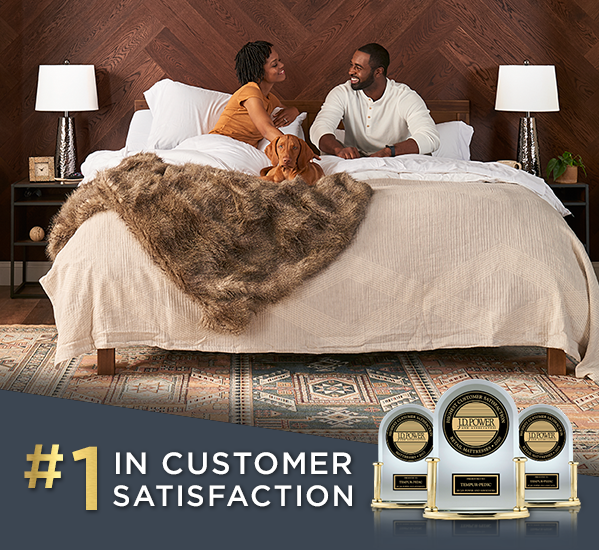 Photo of man, woman, and dog lounging on mattress with overlay text that states #1 in customer satisfaction by JD Power