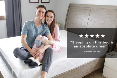 Photo of couple on bed with 5 star review