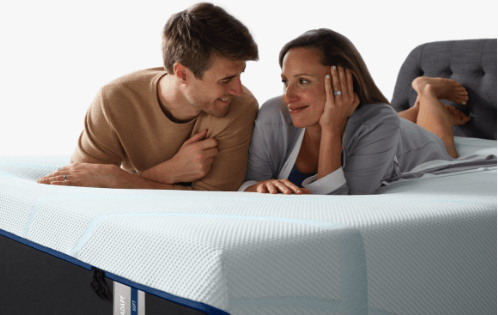 Couple lying on mattress