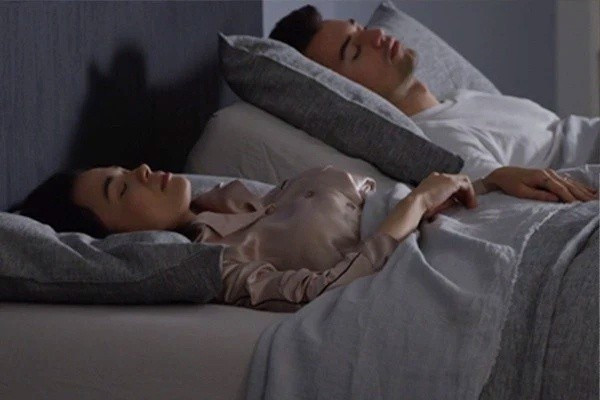 A couple on asleep on a Tempur-Pedic mattress and adjustable power base enjoying the Quiet Mode Feature