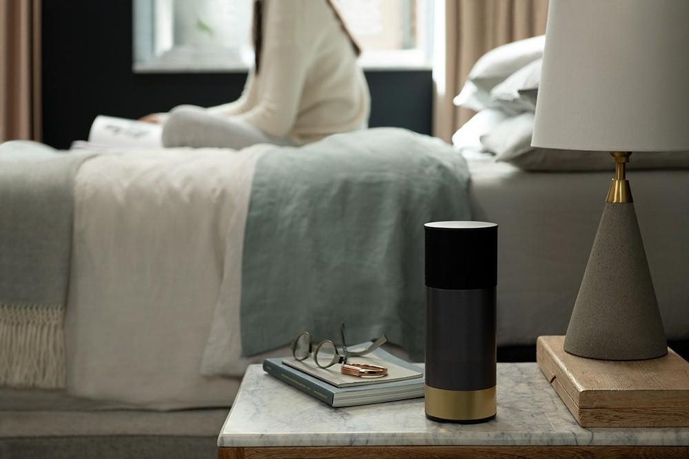 An Amazon Alexa sitting on a nightstand