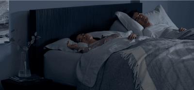a couple sleeping in their split king Tempur mattress