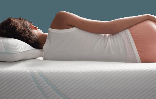 Profile of Woman Lying on Her Body-Adapting Tempur-Pedic