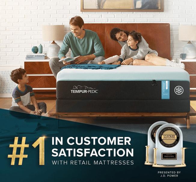 family posing on breeze mattress.