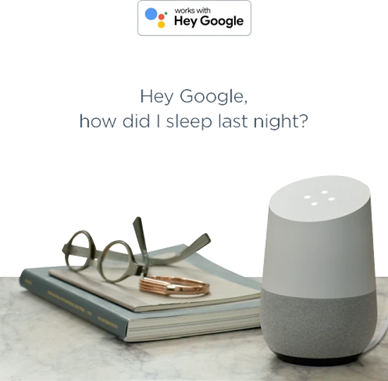 "A google assistant on a night stand with the text ""hey google"""