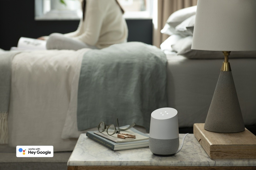 A google assistant on a night stand